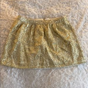 a gold sequined skirt